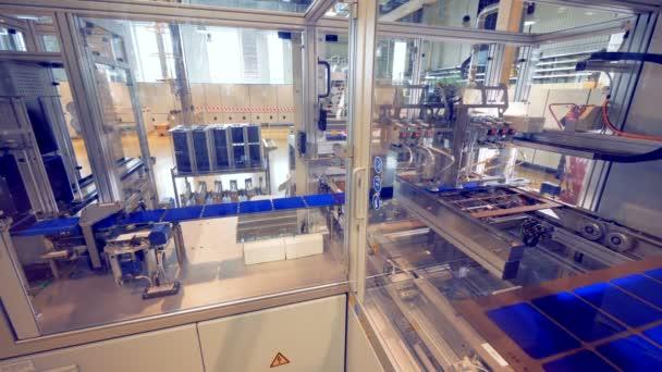 Factory equipment assembles solar modules.