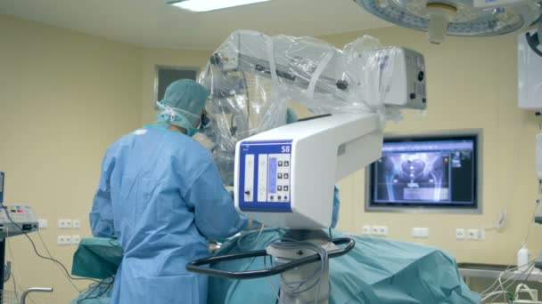 Physicians are performing a surgical procedure in pelvis area