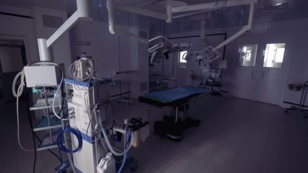 Modern empty surgery with special equipment. Switching on lights in modern surgery.