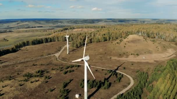 Many wind turbines working outdoors. Wind energy turbines, bird eye view.