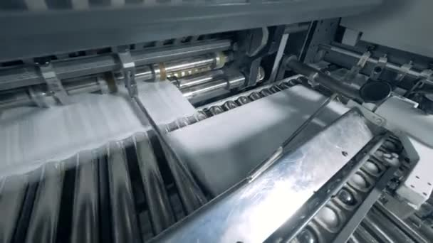 Industrial press is relocating printed pieces of paper