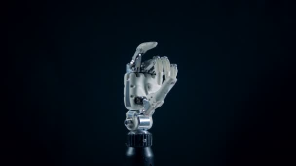 Mechanical arm is clenching its fingers into an okay gesture