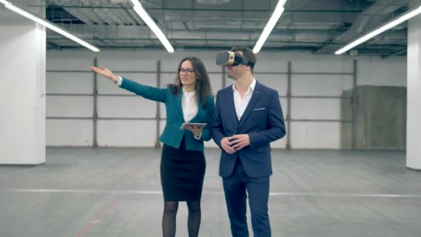 Business people use VR devices while walking in an office room.
