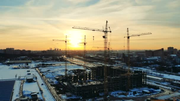 Building cranes in the middle of a project site