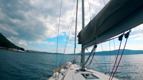 A yacht is sailing across the water in a first-person view
