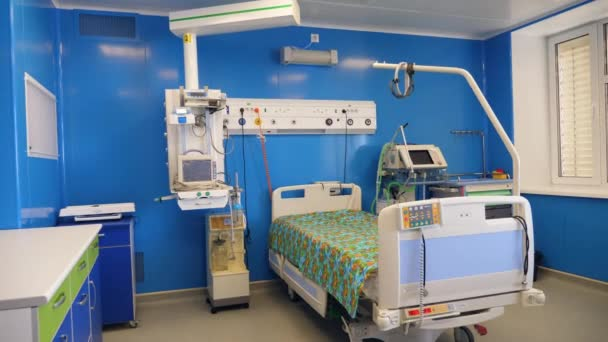 Clean hospital ward with modern equipment and bed.
