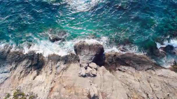Turquoise sea on high coastal cliffs.