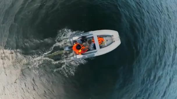 Top view of a person swimming in a dinghy