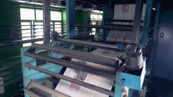 Long sheets of paper at a factory, close up.