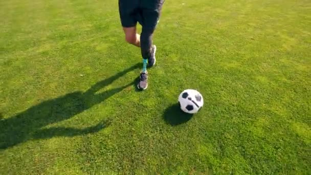 A man with a bionic leg is kicking the ball around