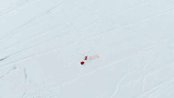 Top view of vast snows and Santa Claus screaming for help