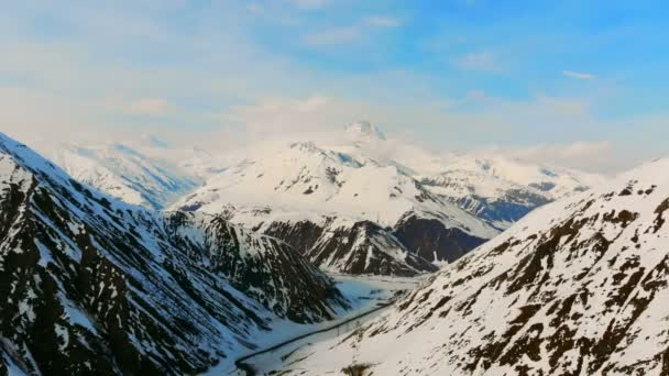 Picturesque scenery of mountain peaks covered with snow