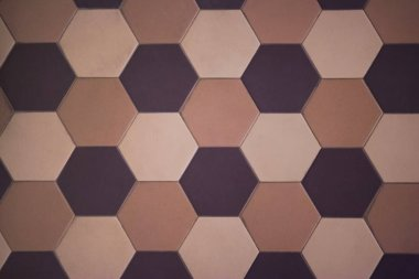 Hexagonal tiles on the wall or floor of a warm color scheme. Modern, fashionable tiles are often used in modern interiors