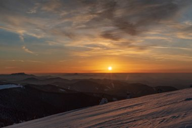 sunset from Veterne hill in winter Mala Fatra mountains in Slovakia