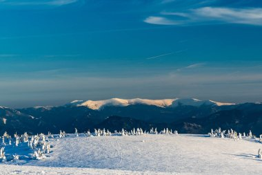 Highest part of Velka Fatra mountains from Martinske hole ridge near Veterne hill in Mala Fatra mountains in Slovakia during beautiful winter day