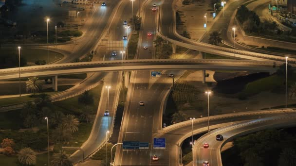 Big road junction in Dubai at night. Accelerated video mode.