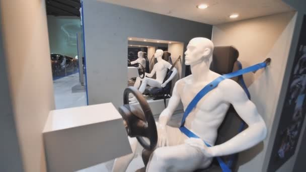 Munich, Germany - August 5, 2018: Exhibition of driver dummies behind the wheel in a BMW museum and BMW Headquarters, Munich, Bavaria, Germany.