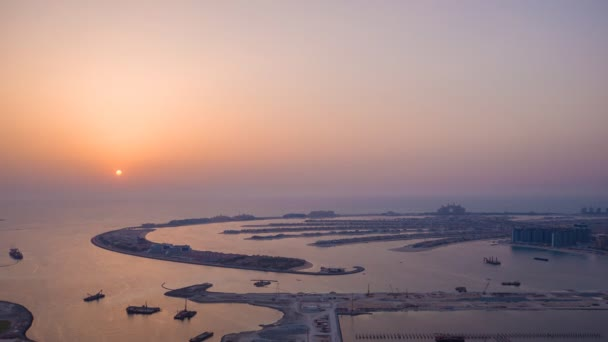 Sunset and night over the artificial islands of Dubai. Timelapse.