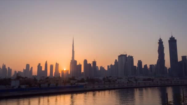 Earlier in the morning Dubai. Sunrise over the skyscrapers of the city. Timelapse