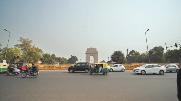 New Delhi, India - November 28, 2018: City car traffic in the background of the India Gate