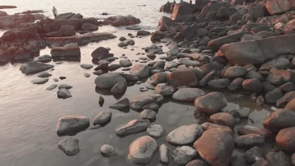 Rocky beach near Palolem beach at sunset. Goa State. India.