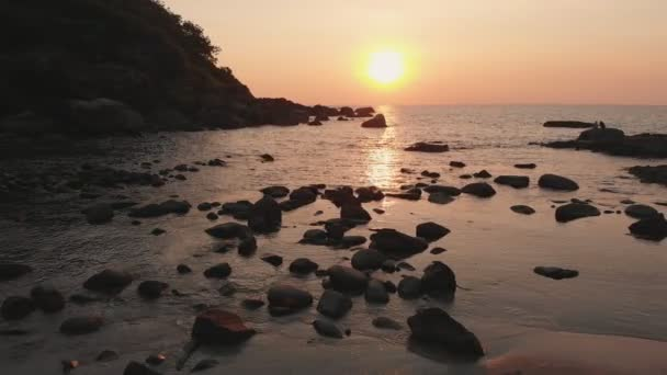 A rocky beach near the Palomem beach at sunset. Goa State. India.