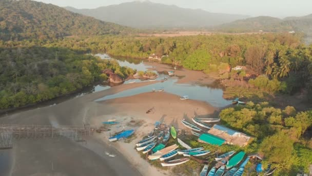 The beautiful nature of the state of Goa near the Palole beach at sunset and fishing boats. India. Drone view.