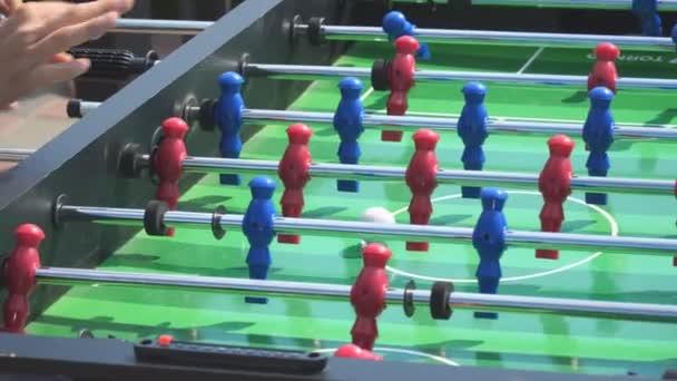People play kicker table football soccer