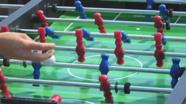 People play kicker table football soccer