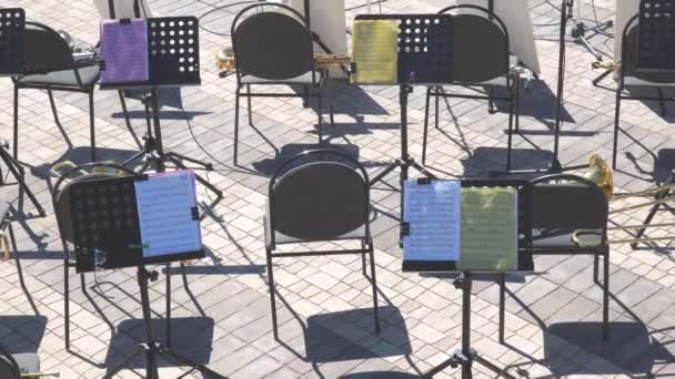 Empty chairs and notes on the music stand