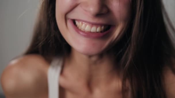 Woman smiling with perfect smile and white teeth laughing smile