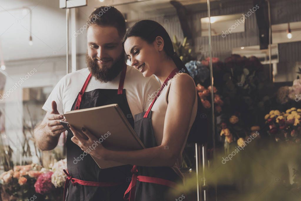 Portrait of smiling florists man and woman