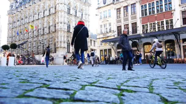 be3a0101b4498 Cyclists and tourists on the square in the center of the European city of  Leuven– stock footage