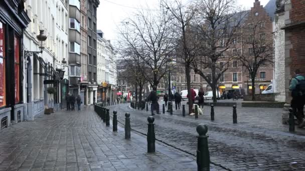 tourists and residents of the city walk along the cobbled street