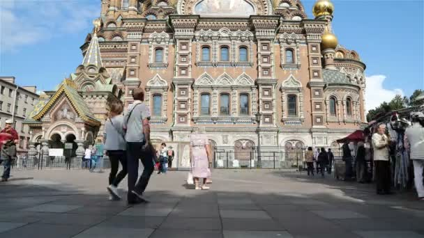 tourists near the Savior on Spilled Blood Cathedral. Fast shot