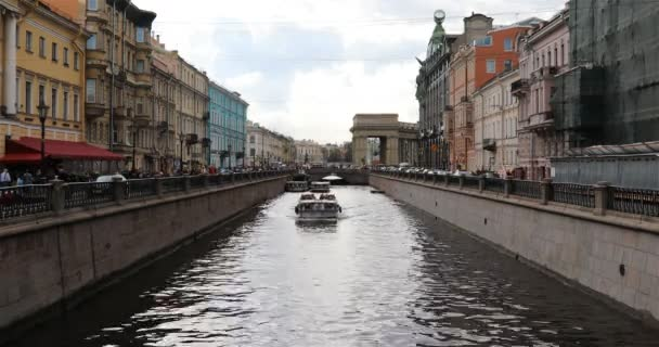 the ship passes through the canal among the streets of the city