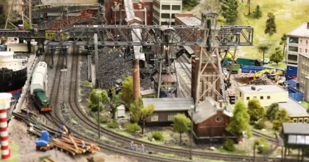 freight train passes coal loading station