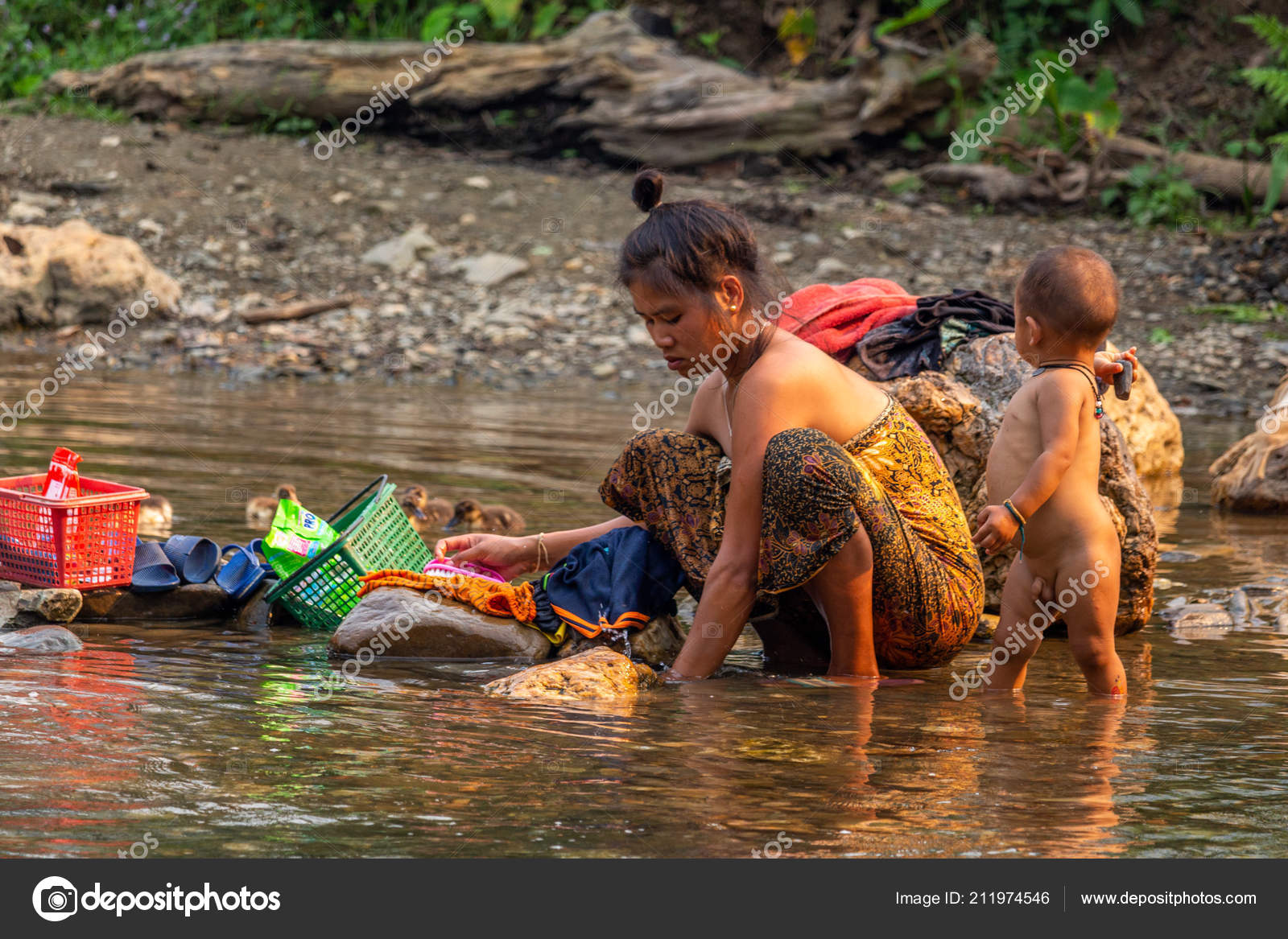 laos child girl bath Dreamstime.com