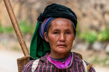 Ha Giang, Vietnam - March 18, 2018: Portrait of a woman from the Hmong ethnic minority walking in the mountains of northern Vietnam
