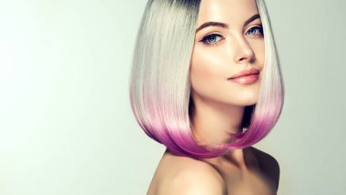 Beautiful hair coloring woman. Fashion Trendy haircut.Ombre bob short hairstyle. Blond model with short shiny hairstyle. Concept Coloring Hair. Beauty Salon