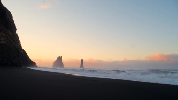 Waves crashing into the rock At Black beach in Iceland