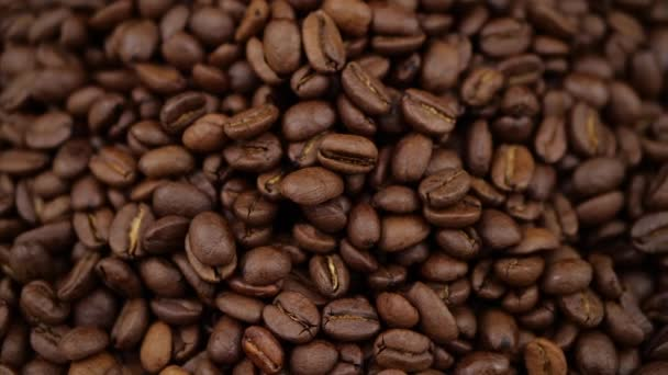 Dark Coffee rotating on board Coffee beans clouse up Beautiful coffee beans.