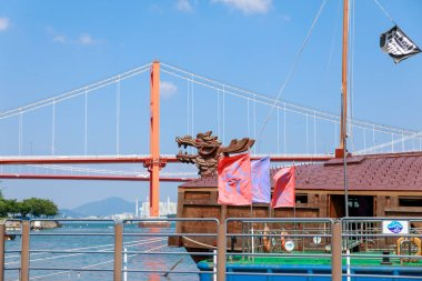 Namhae, South Korea - July 29, 2018 : Namhae Bridge and Yi Sun-sin turtle ship in Namhae County, South Gyeongsang Province