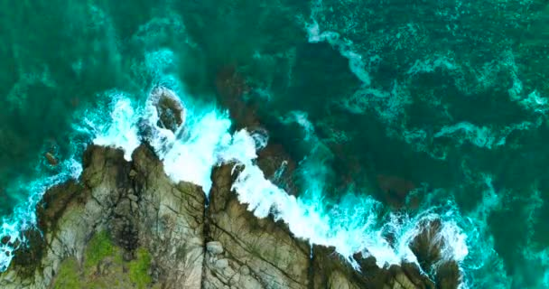 Aerial: Powerful ocean waves are washing up big rocks.