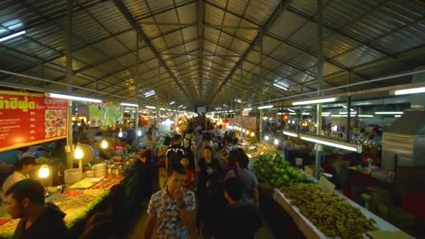 PHUKET, THAILAND September 9, 2018: An Asian food market with crowd of people walking and buying provisions.