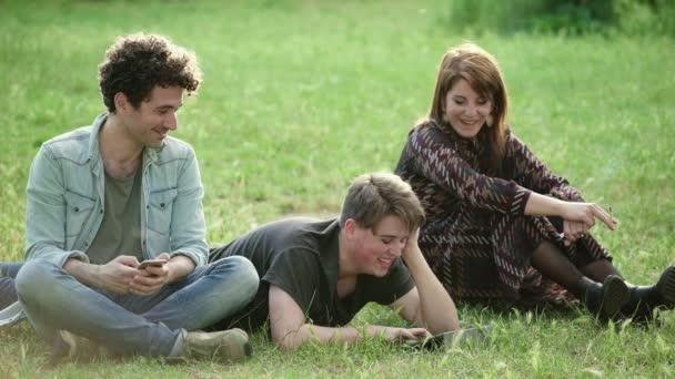 Three Carefree Friends Having Fun Outdoors: summer, freetime, enjoyment