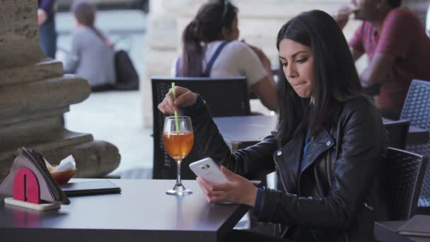 Asian cute young woman using smartphone in a cafe
