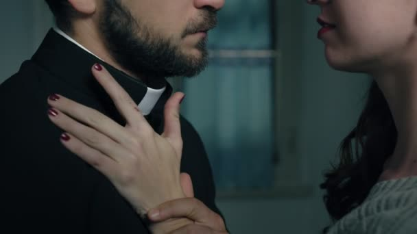passionate kiss between a priest and sexy woman