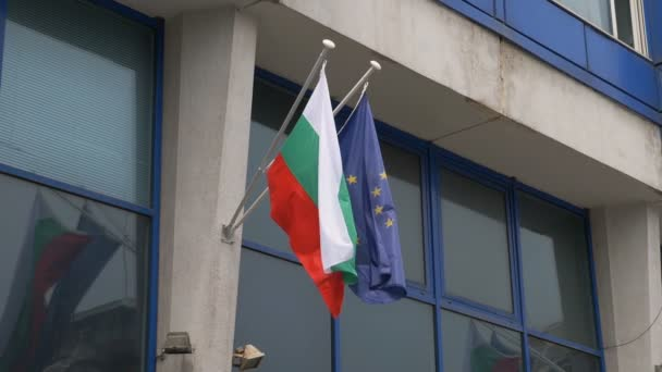Bulgarian and European flags waving together. National identity, Europeanism