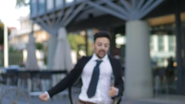 young businessman runs and exults. Success, victory, business